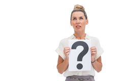 Confused businesswoman with question mark. Looking upwards Royalty Free Stock Photography