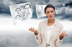 Confused businesswoman standing. Composite image of confused businesswoman standing Royalty Free Stock Photos