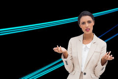 Confused businesswoman standing. Composite image of confused businesswoman standing Royalty Free Stock Photography
