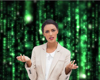 Confused businesswoman standing. Composite image of confused businesswoman standing Royalty Free Stock Images