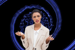 Confused businesswoman standing. Composite image of confused businesswoman standing Stock Photography