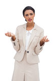 Confused businesswoman standing Stock Images