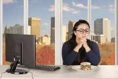 Confused businesswoman to diet Stock Photos