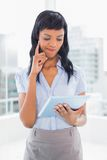 Confused businesswoman using a tablet pc Royalty Free Stock Photography