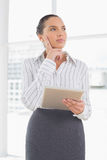 Confused businesswoman using a tablet pc Stock Photos