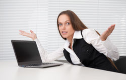 Confused businesswoman. Confused young business woman at the office Stock Photography