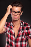 Confused casual man with glasses. Sctratching his head royalty free stock photography