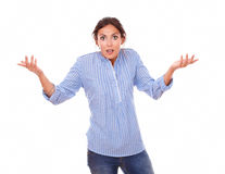 Confused charming woman holding up her hands Stock Photos