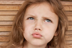 Confused child. Portrait of a very confused little girl stock image