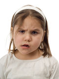 Confused Child. Closeup of a young child making a confused face, isolated against a white background Stock Photography