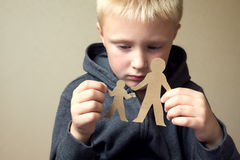 Confused child with paper father and son Royalty Free Stock Image