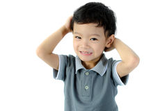 Confused child scratching his head Royalty Free Stock Photo