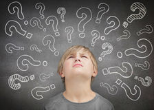 Confused child thinking. And looking up Stock Image