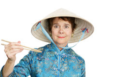 Confused by Chopsticks Royalty Free Stock Photography