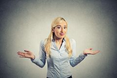 Confused clueless woman arms out shrugs shoulders Royalty Free Stock Image