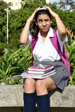Confused Colombian Girl Student Wearing Uniform With Books Sitting