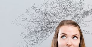 Confused concept with young woman stock photography