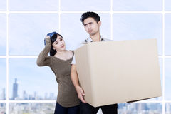 Confused couple bring box at apartment Royalty Free Stock Photo