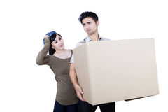 Confused couple bring box - isolated Royalty Free Stock Image