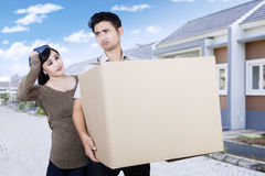 Confused couple moving from new house Royalty Free Stock Image