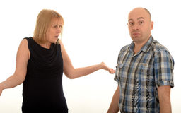 Confused couple. Portrait of a confused middle aged couple with the woman shrugging her shoulders, white studio background Royalty Free Stock Photography