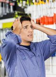 Confused Customer With Hands On Head In Hardware Royalty Free Stock Images