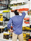Confused Customer Scratching Head In Hardware Shop Stock Images