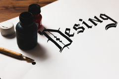 Confused design word. Confused desing word made with ink in a calligraphy style. Negligence, mistake, stupidity, illiteracy concept Stock Image