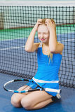 Confused or distressed girl on a tennis court Stock Photos