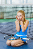 Confused or distressed girl on a tennis court Stock Image