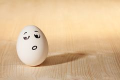 Confused drawn face expression. White egg with confused worried drawn facial expression Stock Images