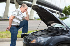 Confused driver standing near broken car Royalty Free Stock Photo