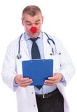 Confused fake doctor acting like a clown Stock Photo
