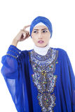 Confused female muslim in blue dress - isolated Stock Photography