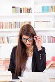 Confused  female student with glasses Royalty Free Stock Photography