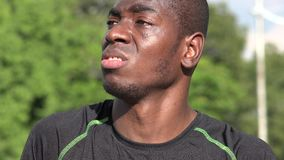 Confused or forgetful African male athlete. A handsome young black male stock video footage