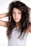 Confused girl with crazy hairdo Royalty Free Stock Photography