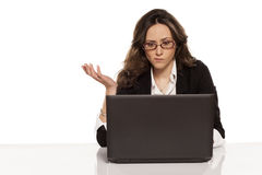Confused girl with a laptop. And do not know what to do further stock photos