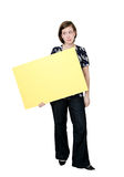 Confused girl with sign. Confused woman with a big blank sign Royalty Free Stock Image