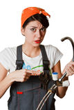 Confused girl trying to repair tap Royalty Free Stock Photos