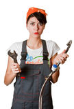 Confused girl trying to repair tap Stock Photo