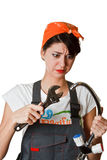 Confused girl trying to repair tap Royalty Free Stock Photo