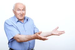Confused grandfather holding hands up Royalty Free Stock Photography
