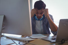 Confused graphic designer sitting in office. Confused male graphic designer sitting in office stock images