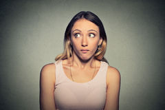 Confused guilty looking woman Royalty Free Stock Photos