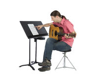 Confused guitarist looking to the notations confused Royalty Free Stock Photos