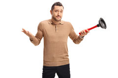 Confused guy holding a plunger Royalty Free Stock Photos