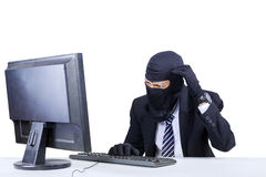 Confused hacker in business suit Stock Images