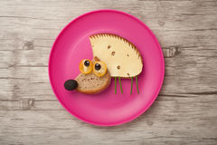 Confused hedgehog made of bread and cheese Stock Image