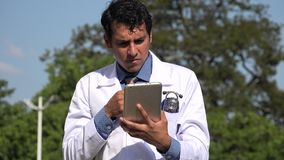 Confused hispanic doctor using tablet thinking. A handsome adult hispanic man stock video